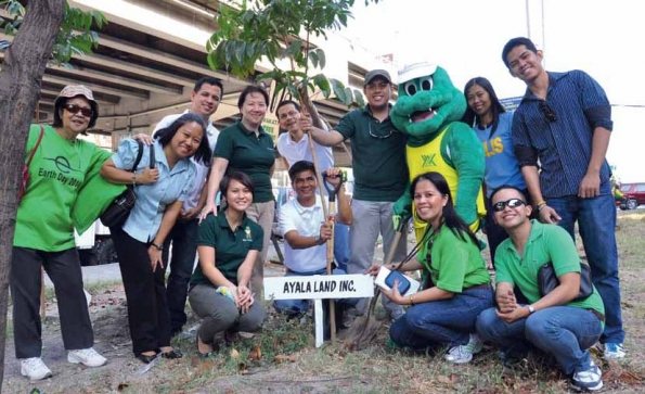 Ayala Land employee-volunteers tree-planting activity